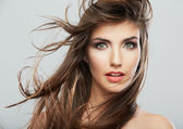 Female face with hair motion — Stock Photo