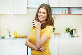 Woman in kitchen — Stock Photo