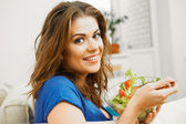 Woman eating salad — Stock Photo