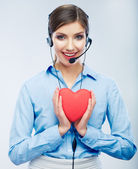 Woman call center operator hold love symbol of Valentine day. R — Stock Photo
