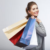 Woman holding shopping bags — Stockfoto