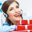 Smiling operator seat at table with red gift box. Happy busines — Stock Photo #34522893