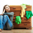 Young woman with clothes at home — Stock Photo #34523421