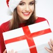 Close up portrait of woman in santa hat holding gift box — Stock Photo