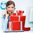 Smiling operator seat at table with red gift box. Happy busines — Stock Photo #34526279