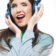 Young winking woman with headphones — Stock Photo