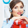 Smiling operator seat at table with red gift box. Happy busines — Stock Photo #34528961