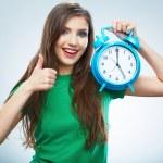 Woman holding clock — Stock Photo #34529145