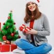 Happy woman in Santa hat — Stockfoto