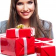 Close up portrait of woman holding gift boxes — Stock Photo