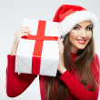 Close up portrait of woman in santa hat holding gift box — Stock Photo #34529755