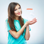 Portrait of young smiling woman hold white paper ship. Female m — Stock Photo