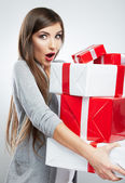 Woman holding gift boxes — Stock Photo