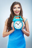 Smiling woman holding watch — Stok fotoğraf