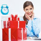Business woman at work in office. Red gift box on table — Stock Photo