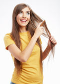 Woman combing hair — Stock Photo