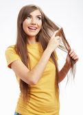 Woman combing hair — Stock Photo
