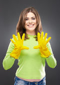 Woman with yellow working gloves — Stock Photo
