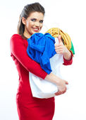 Woman with thumb up holding shopping bag with clothes — Stock Photo