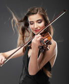 Portrait of woman playing violin — Stock Photo