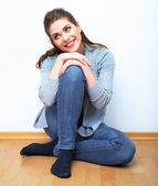 Portrait of woman sitting on floor — Stock Photo
