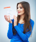 Young woman holds white paper ship — Stock Photo
