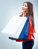 Smiling woman holds shopping bags — Stock Photo