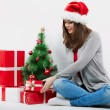 Happy woman in Santa hat — Stock Photo #34533435