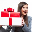 Portrait of business woman holding gift boxes — Stock Photo