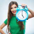 Woman holding clock — ストック写真
