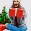 Happy woman in Santa hat — Stock Photo #34532577