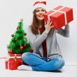 Happy woman in Santa hat — Stock Photo #34533253