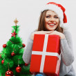 Happy woman in Santa hat — Stock Photo #34536009