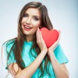Red heart. Love symbol. Portrait of beautiful woman hold Valent — Stock Photo