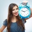 Woman holding clock — Stockfoto