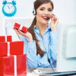 Smiling operator seat at table with red gift box. Happy busines — Stock Photo #34538125