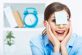 Smiling business woman with blank paper on head. — Stock Photo