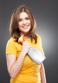 Smiling woman holding spray — Stock Photo