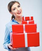 Business woman holding gift box — Stock Photo