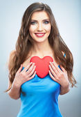 Happy woman holding love symbol — Stock Photo