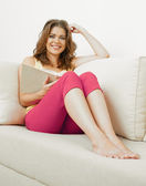 Woman on sofa at home — Stock Photo