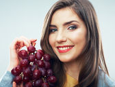 Woman with grape — Stock Photo