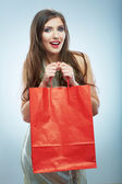 Smiling woman with shopping bag — Stockfoto
