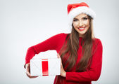 Portrait of woman in santa hat holding gift box — Stock Photo