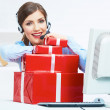 Smiling operator seat at table with red gift box. Happy busines — Stock Photo #34541797
