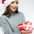 Portrait of woman in santa hat holding gift boxes — Stock Photo
