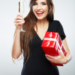 Woman holding gift box and glass of champagne — Stock Photo #34542837
