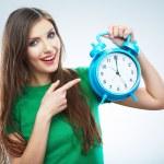 Woman holding clock — Stock Photo #34542939