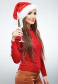 Woman in santa hat holding glass of champagne — Foto de Stock