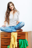 Young woman with clothes at home — 图库照片